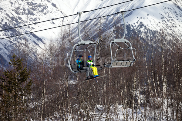Father and daughter on chair-lift at nice sunny day Stock photo © BSANI