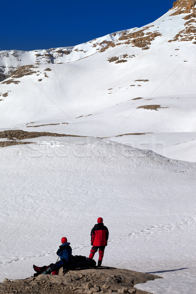 Two hikers on halt in snow mountains Stock photo © BSANI