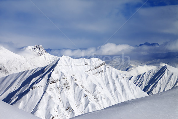 Off-piste slope and cloudy mountains at nice evening Stock photo © BSANI