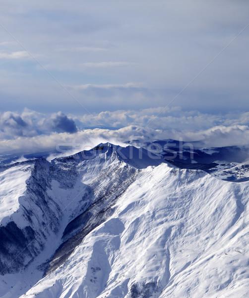 Inverno montanhas névoa ventoso dia cáucaso Foto stock © BSANI