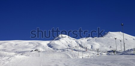 Snowboarders move on footpath to off piste slope at sun day Stock photo © BSANI