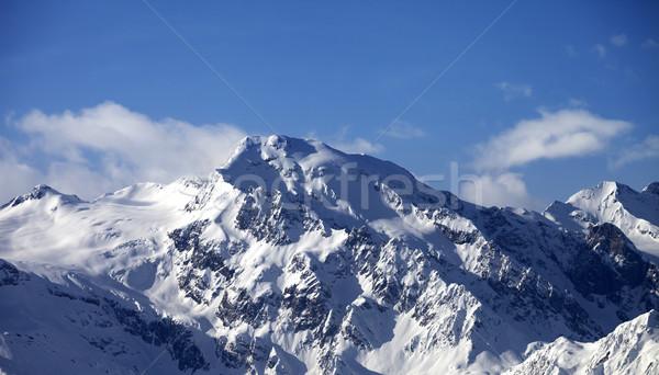 Snowy mountains at sun day Stock photo © BSANI