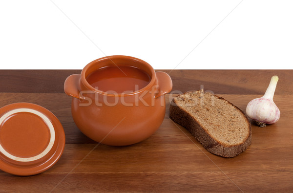 Soup in ceramic pot with bread and garlic Stock photo © BSANI