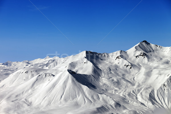 Winter mountains and blue sky Stock photo © BSANI