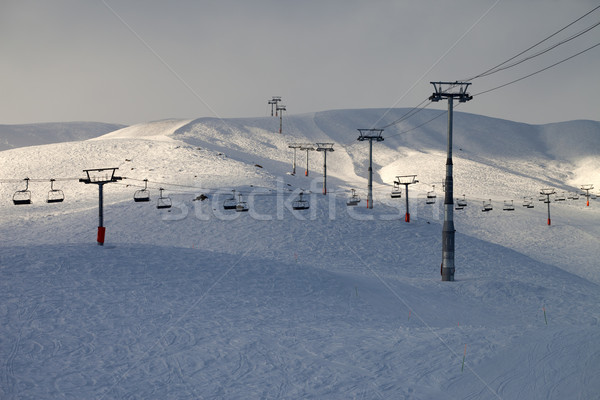 Ski slope with chair-lift in evening Stock photo © BSANI