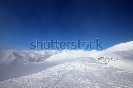 Warning sing on ski slope and snowy mountains in haze Stock photo © BSANI