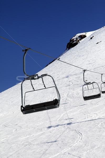 Chair-lift in ski resort at sun day Stock photo © BSANI
