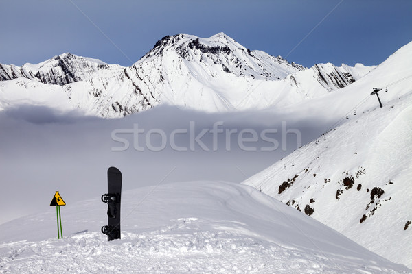 Warning sing and snowboard on off-piste slope Stock photo © BSANI
