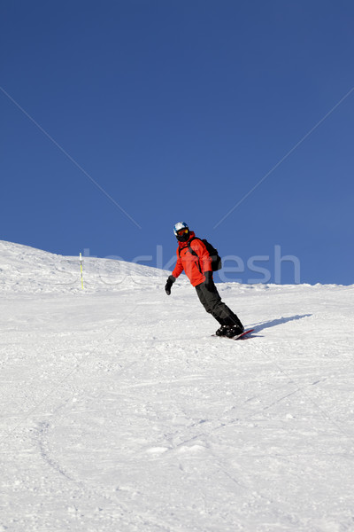 Snowboarder on ski slope at nice day Stock photo © BSANI