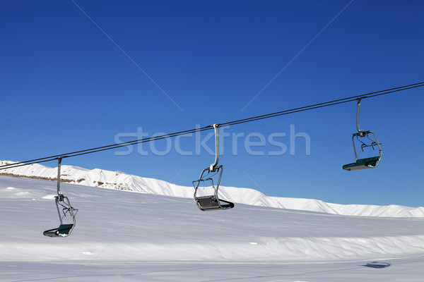 Chair-lift and blue sky at sun day Stock photo © BSANI