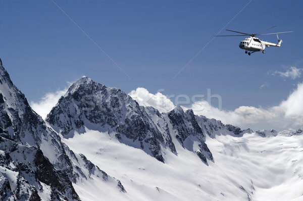 Helicopter in high mountains Stock photo © BSANI