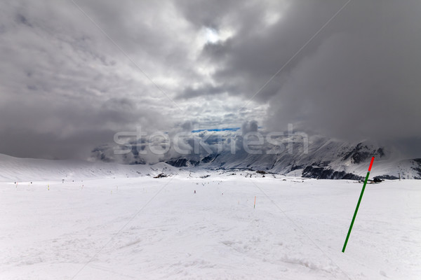 Slope for slalom and sky with storm clouds Stock photo © BSANI