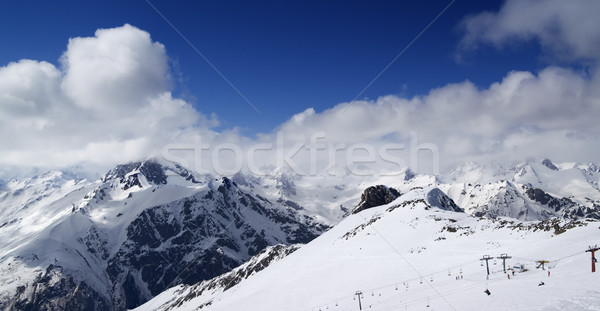 Panoramic view on ski slope and cloudy mountains at nice sun day Stock photo © BSANI