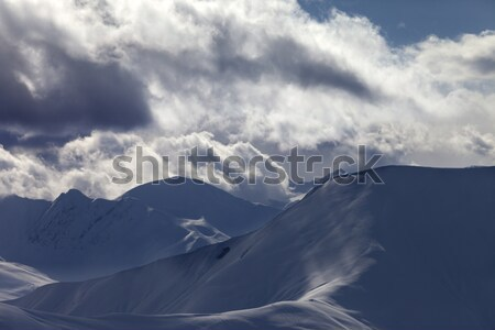 Off piste slope in sunlight clouds at evening Stock photo © BSANI
