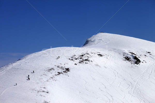 Snowboarders and skiers downhill on off piste slope at sun day Stock photo © BSANI