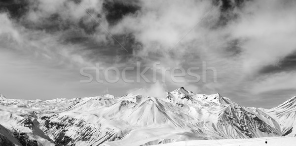 Black and white snowy mountains at wind day Stock photo © BSANI