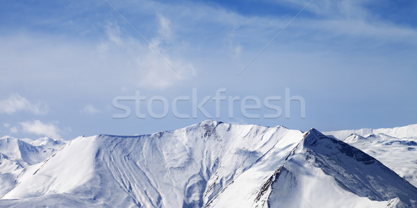 Panoramic view on snowy mountains with avalanches Stock photo © BSANI