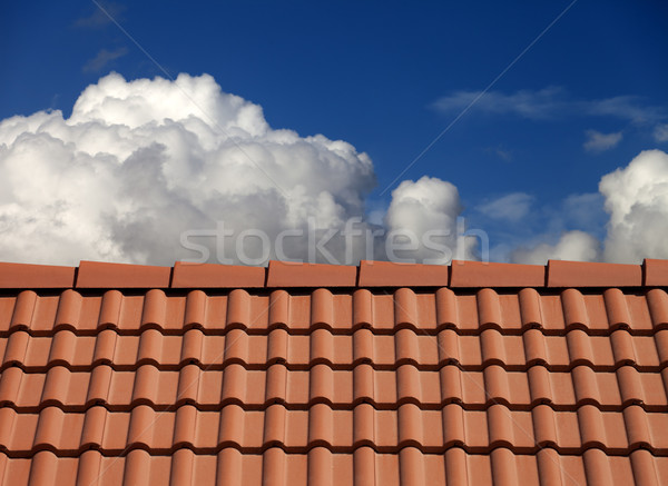 Roof tiles and blue sky with clouds Stock photo © BSANI