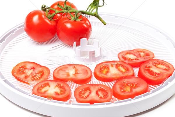 Ripe tomato on food dehydrator tray Stock photo © BSANI