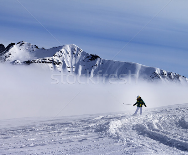 Snowboarder downhill on off-piste slope with newly fallen snow Stock photo © BSANI