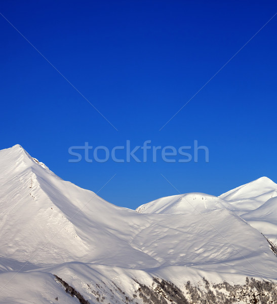 Snowy mountains and blue clear sky at nice morning Stock photo © BSANI