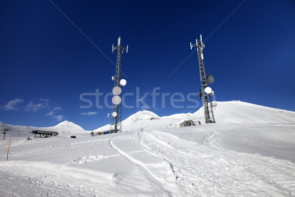 Stock photo: Ratrac ski road and satellite dishes at nice sun day