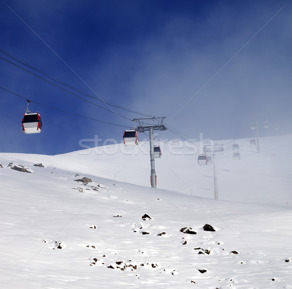 Gondola lifts and ski slope in mist Stock photo © BSANI