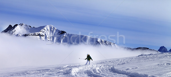 Panoramic view on snowboarder downhill on off-piste slope with n Stock photo © BSANI