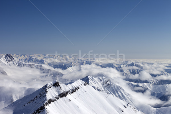 Snowy mountains in haze Stock photo © BSANI