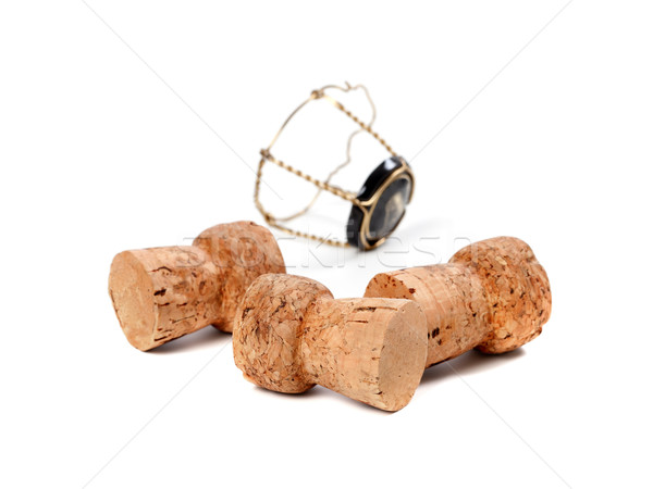 Three corks from champagne wine and muselet isolated on white ba Stock photo © BSANI