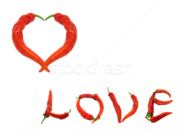 Heart and word Love composed of red chili peppers Stock photo © BSANI