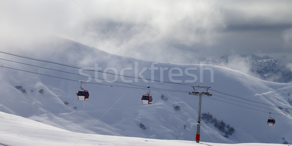 Panoramic view on gondola lifts and off-piste slope in mist Stock photo © BSANI