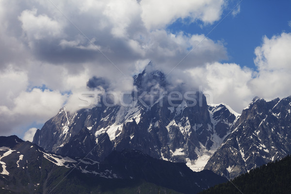 Mt. Ushba in clouds, Caucasus Mountains, Georgia. Stock photo © BSANI
