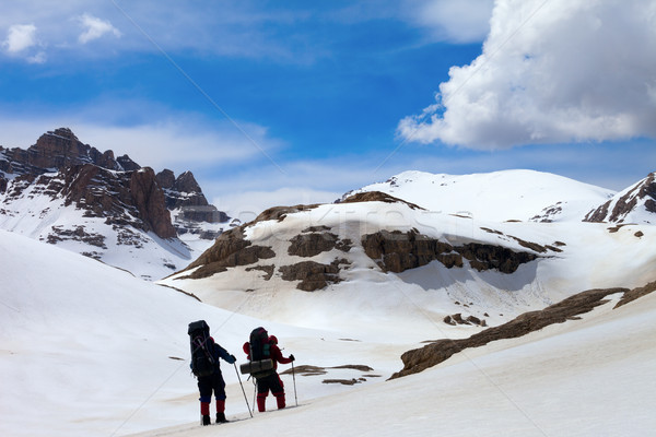 Two hikers in snow mountains Stock photo © BSANI