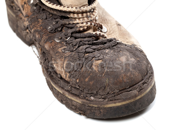 Part of old dirty hiking boot on white background Stock photo © BSANI