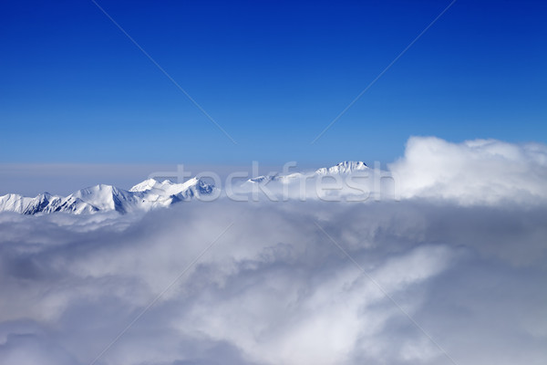 Mountains in clouds at nice sun day Stock photo © BSANI