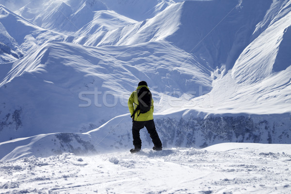 Snowboarder on top of off-piste slope at windy day Stock photo © BSANI