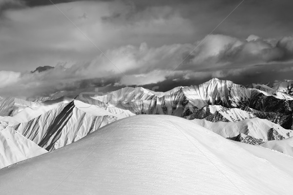 Black and white  off-piste snowy slope and cloudy mountains Stock photo © BSANI