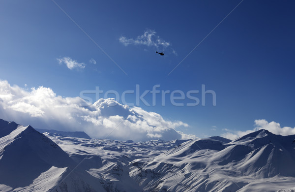 Helicopter above snowy plateau Stock photo © BSANI