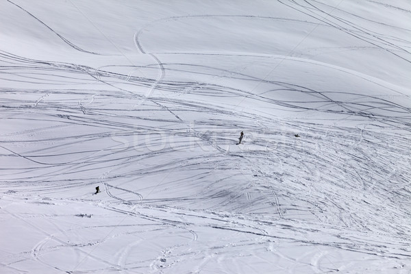 Silhouettes of snowboarders and skiers on off piste slope Stock photo © BSANI