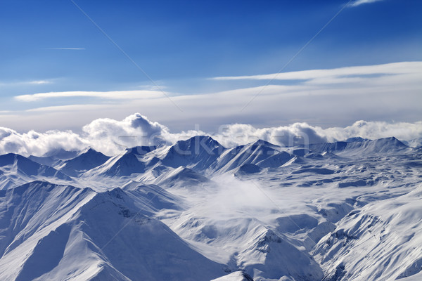 Snow plateau and sunlight sky with clouds in evening Stock photo © BSANI