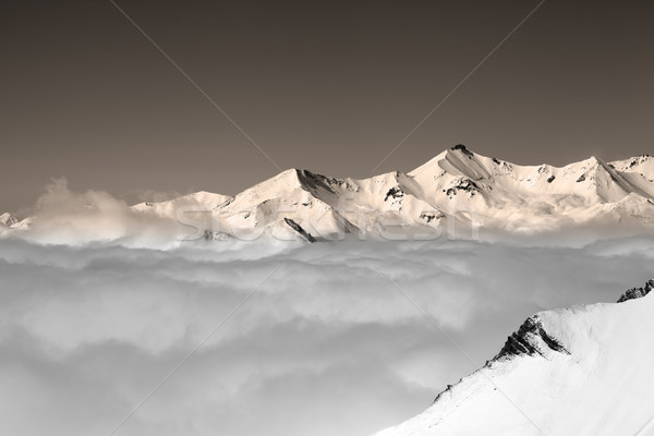 Vintage winter mountains under clouds Stock photo © BSANI