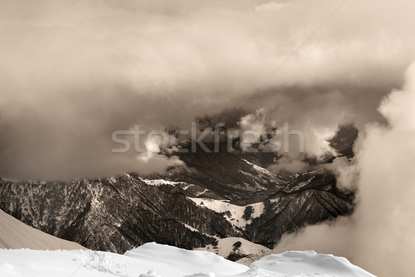 Sepia snowy mountains in clouds Stock photo © BSANI