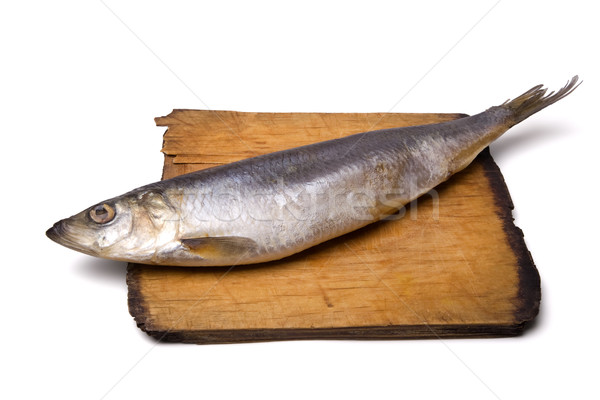 Herring on old wooden board Stock photo © BSANI