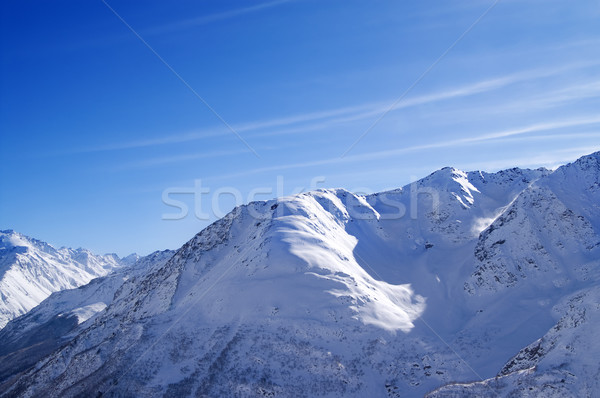Snowy sunlight mountains, view from off piste slope Stock photo © BSANI