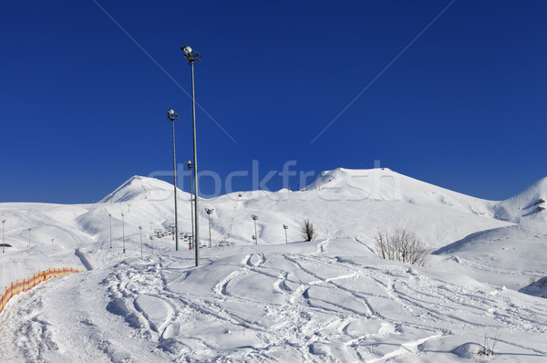 Winter mountains and ski slope at nice sun day Stock photo © BSANI