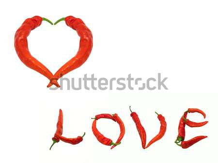 Stock photo: Two hearts composed of red chili peppers