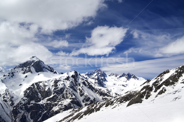 Snowy mountains in wind day Stock photo © BSANI