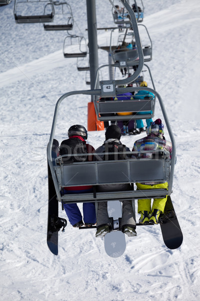 Snowboarders on chair-lift Stock photo © BSANI