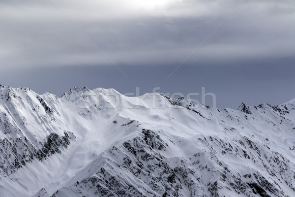 High snowy mountains and sunlight storm sky before blizzard Stock photo © BSANI